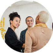 Two Businesswomen advising mature client